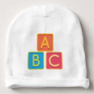 Um alfabeto de B C obstrui o chapéu do Beanie do Gorro Para Bebê