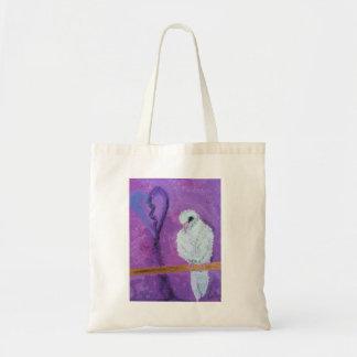 Um bolsa temático roxo da pomba