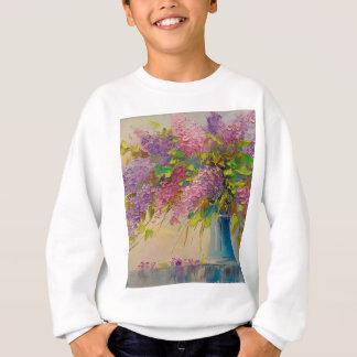 Um buquê dos lilacs agasalho