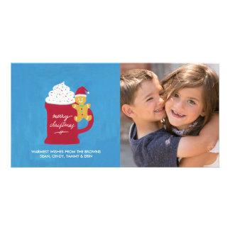 Um copo do cartão com fotos do Feliz Natal