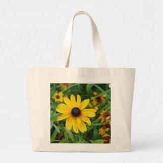 Um fim bonito acima de uma flor amarela bolsa