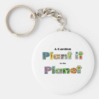 Um jardim, planta-o para o planeta, slogan earthda chaveiros