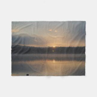 Um nascer do sol bonito cobertor de velo