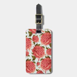 Um respingo da peônia, um traço da cor etiqueta de bagagem