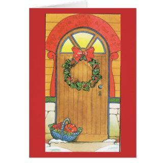 Uma boa vinda do Natal, porta decorada Cartões
