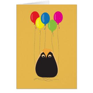 Uma coruja afortunada com balões felizes cartão comemorativo