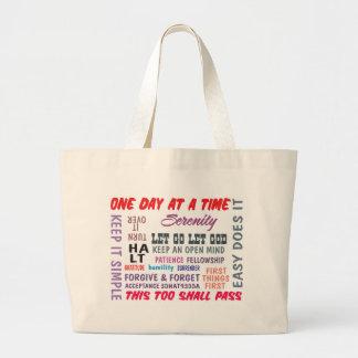 uma disposição de slogan do aa bolsas de lona