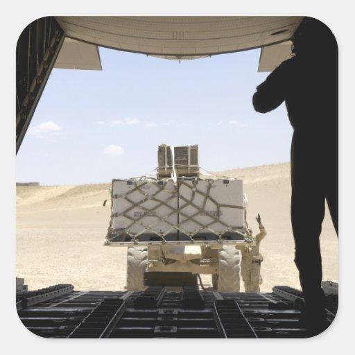 Uma empilhadeira carrega a carga em A.A. - 130 Adesivo Em Forma Quadrada