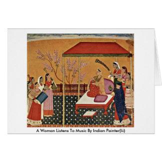 Uma mulher escuta a música pelo pintor indiano Ii Cartões