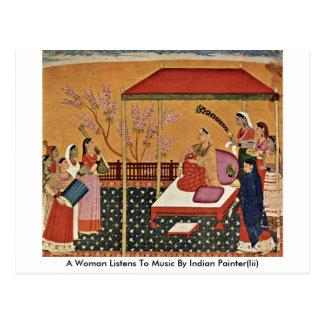 Uma mulher escuta a música pelo pintor indiano Ii Cartoes Postais