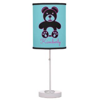 Urso cor-de-rosa magenta brilhante com a lâmpada