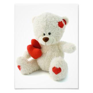 Urso de ursinho branco que guardara um coração impressão de foto
