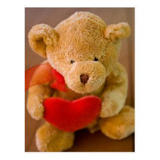 Urso de ursinho enchido que guardara um cartão do