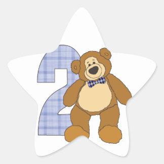 Urso de ursinho formal da criança de 2 anos com adesito estrela