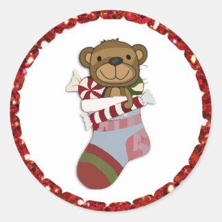 Urso do Natal em etiquetas da meia