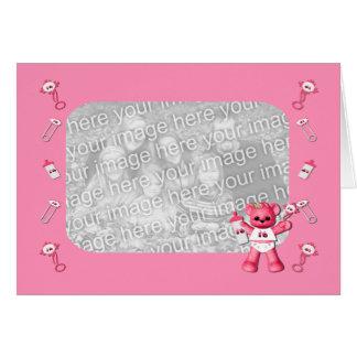 Urso do rosa de bebê e cartão com fotos cor-de-ros