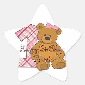 Urso feliz do primeiro aniversario da menina com 1 adesito estrela