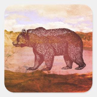 Urso nas etiquetas da paisagem