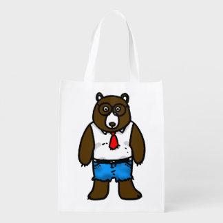 Urso selvagem marrom do hipster com um laço vermel sacolas ecológicas para supermercado