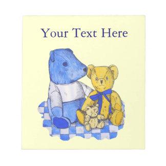 ursos de ursinho bonitos azuis e pano branco do bloco de anotação