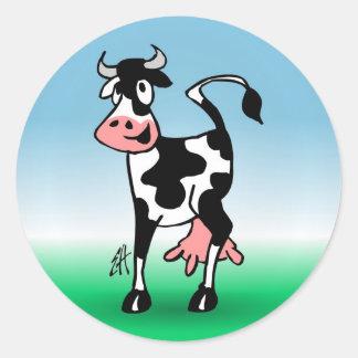 Vaca alegre em um prado adesivo