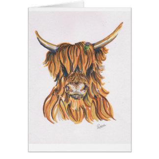 Vaca das montanhas com o cartão de presente do