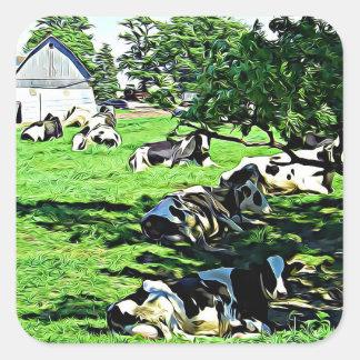 Vacas em uma fazenda que descansa em etiquetas de
