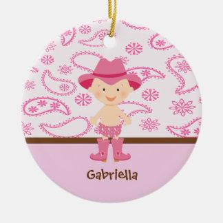 Vaqueira bonito do bebê no ornamento cor-de-rosa