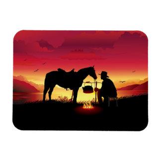 Vaqueiro e cavalo no ímã de Flexi do por do sol