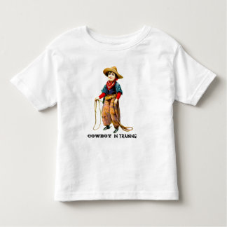 VAQUEIRO no t-shirt da criança do treinamento