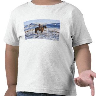 Vaqueiro que monta um cavalo na escala no camisetas