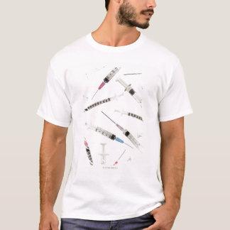 Variedade das seringas em vários tamanhos e camiseta