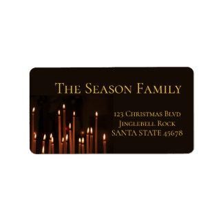 Velas ardentes da etiqueta do Natal