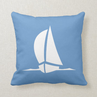 veleiro branco no travesseiro azul almofada