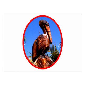 Vermelho de madeira do pelicano o os presentes de cartao postal