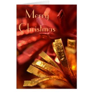 Vermelho e cartão de Natal do ouro