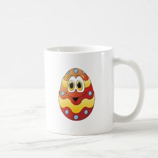 Vermelho engraçado do ovo da páscoa caneca