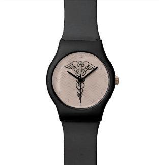 Vigas médicas do símbolo do Caduceus do relógio  