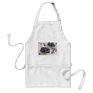 Vista macro nas especiarias da cozinha em uma avental