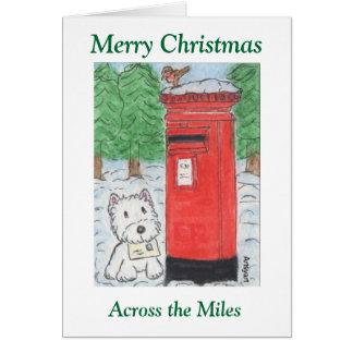 Westie através do cartão de Natal das milhas