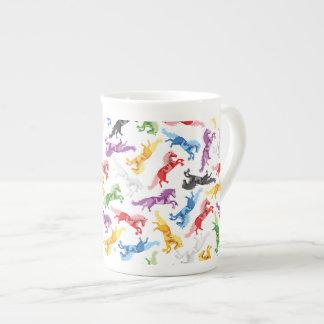 Xícara De Chá Cavalos de salto coloridos do teste padrão