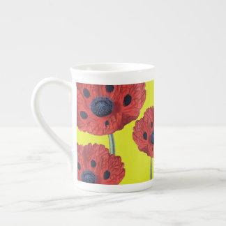 Xícara De Chá Papoilas vermelhas no amarelo