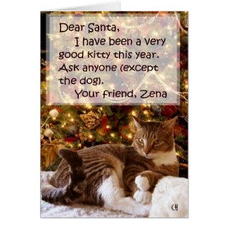 Zena sob o cartão de Natal da árvore